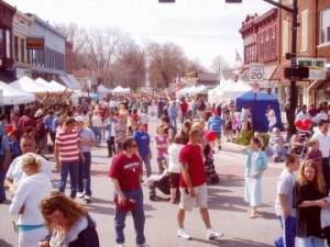 Lots of visitors and booths fill the street at Wakarusa Maple Syrup Festival